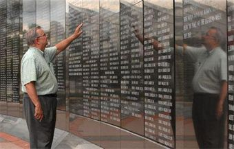 Ray Moore – Founder of the Jacksonville Veterans Memorial Wall in Jacksonville, FL, extending his hand to some of our fallen heroes who gave their lives to protect our way of life. The memorial was dedicated on November 11, 1995.